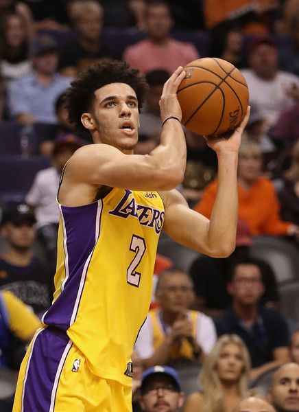 Lonzo Ball Photos - Lonzo Ball #2 of the Los Angeles Lakers attempts a shot during the NBA game against the Phoenix Suns at Talking Stick Resort Arena on October 20, 2017 in Phoenix, Arizona. The Lakers defeated the Suns 132-130.  NOTE TO USER: User expressly acknowledges and agrees that, by downloading and or using this photograph, User is consenting to the terms and conditions of the Getty Images License Agreement. - Los Angeles Lakers v Phoenix Suns
