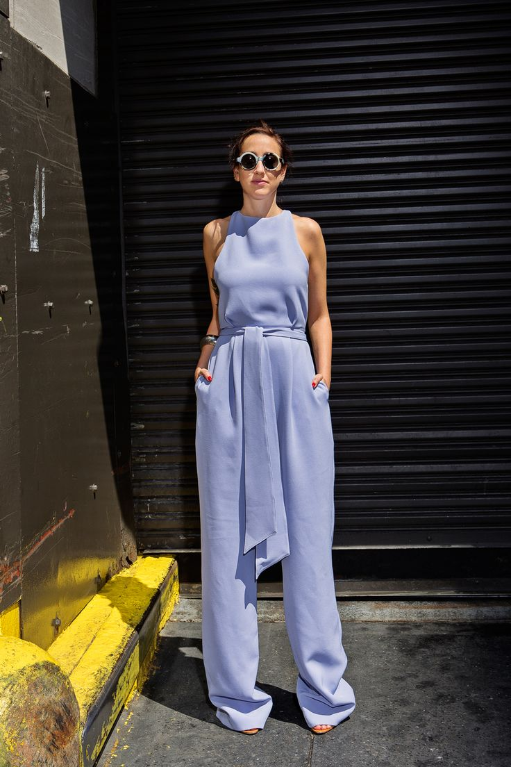 """What WE'RE Wearing This Fashion Week  #refinery29  http://www.refinery29.com/outfit-ideas-fashion-week-2014#slide50  """"If I could wear a jumpsuit every day, I would. They're fun and a one-stop piece in my closet. This one from Whistles is super figure-flattering — the tie gives me a cinched-in waist while the super-long and wide pant legs make me look extra tall."""" Whistles jumpsuit."""