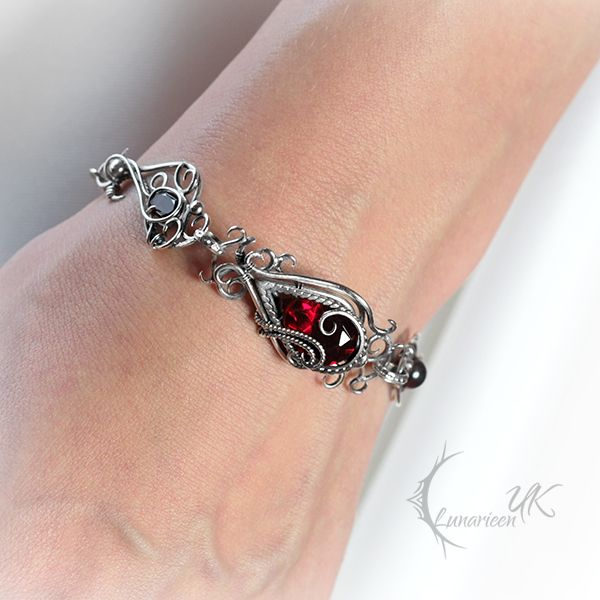 YARGHNIZ - Silver, Red Quartz and Garnets. by LUNARIEEN.deviantart.com on @DeviantArt