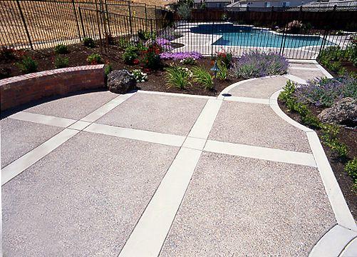 exposed aggregate patio with border   Bi-Level Exposed Aggregate Patio and Pool Deck Accented with Flagstone ...