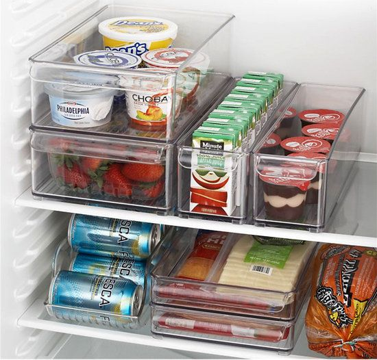 Use clear stackable bins to organize fridge.
