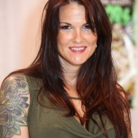 wwe former champion lita ,.,.tattoos and meanings