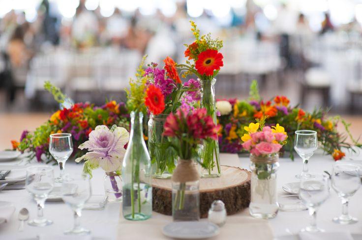Wedding table, tablescape, wood, bottle, flowers, centerpiece