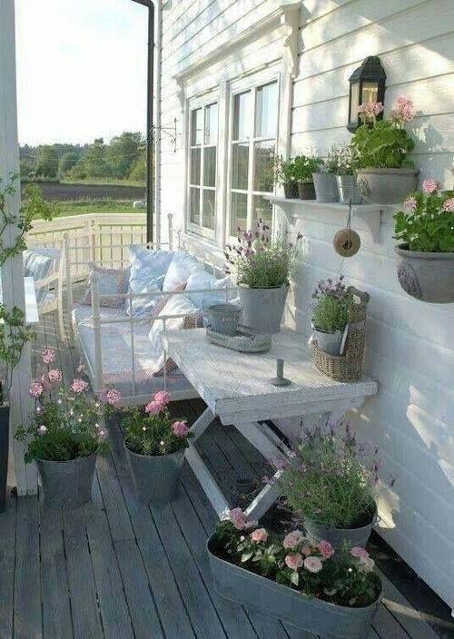 lovely porch via AllHomeLiving