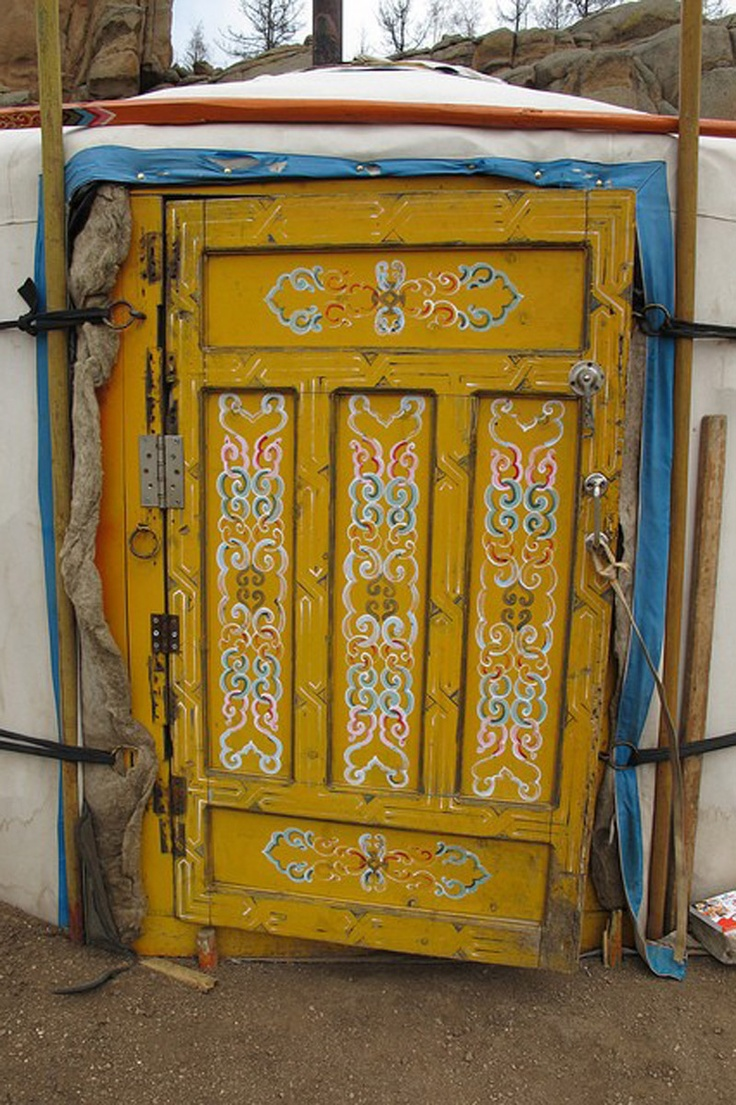 Mongolian yurt (ger) door.  Gers are traditional Mongolian homes and have been in Ulaanbaatar since the 17th century, easily portable rounded wooden structures covered by a heavy felt blanket and heated by a stove in the center of the structure.