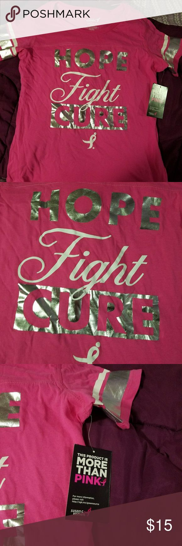 """Susan G Komen pink fight cancer shirt Design looks kind of like a jersey. Pink with silver and white stripes on the arms. Shirt says """"Hope, Fight, Cure"""".  Size large. susan g komen Tops Tees - Short Sleeve"""