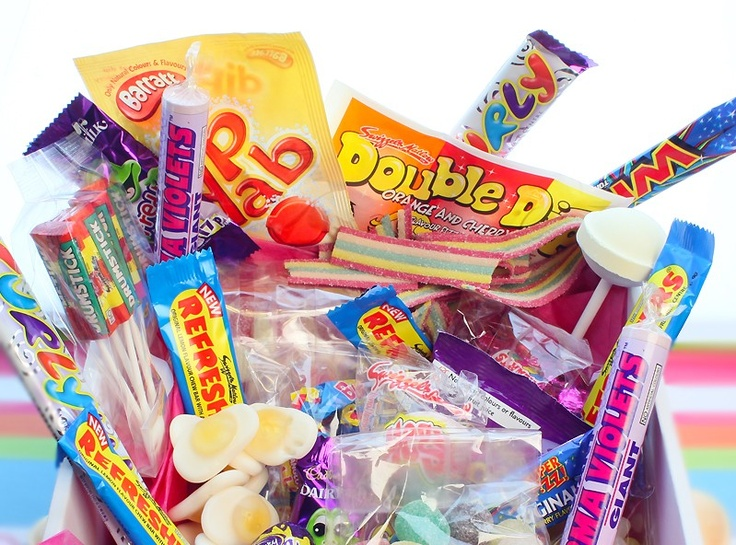 Each box contains: 1 bag Sherbert Lemons / 1 bag Rhubarb and Custard / 1 bag mini Love Heart rolls / 1 bag Jelly Beans / 1 bag Hard Gums / 1 bag Tooty Fruitys / 1 bag Fruit Salads / 1 bag Shrimps / 1 x Curly Wurly / 8 x Anglo Bubbly / 10 x Flying Saucers / 1 x Parmaviolets / 1 x bag FIzzy Cola Bottles / 5 x Drum Stick Lollies / 1 x Double Dip / 1 x Mega Double Lollies / 2 x Refresher Chews / 1 x Dip Dab / 1 x Freddo Frogs /1 bag Harribo Jelly Babies / 1x Finger of Fudge