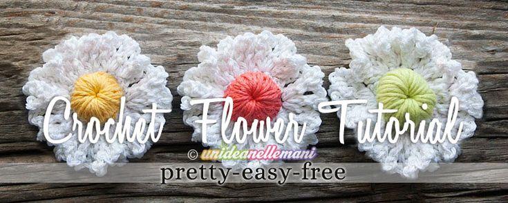 Tutorial con foto e spiegazioni per creare fiori all'uncinetto tridimensionali, bicolore, da applicare adatti per l'estate o anche per l'inverno