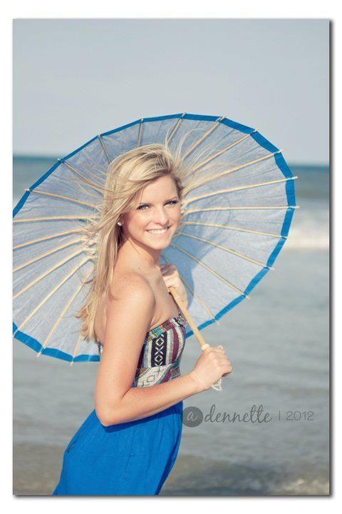 Great idea for a senior beach shoot... would help w/ the sun, too.  They sell paper umbrellas @ Hobby Lobby!    Photo by A. Dennette Photography