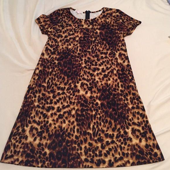 Cheetah licious dress!  Nwo never worn cheetah dress! Simple cut and looks great on anyone! Mavorie Dresses Mini