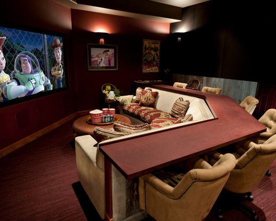 This is an awesome idea for a movie/ family room! Minus the ugly fabric pattern.