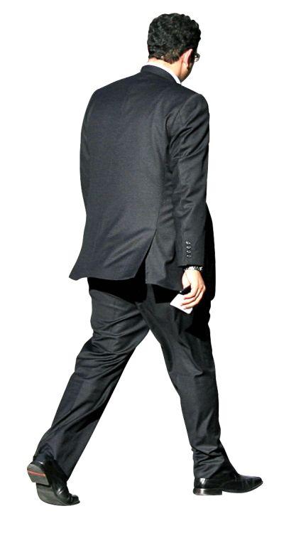 Man in suit walking outside alex proimos cc attribution Architect suit
