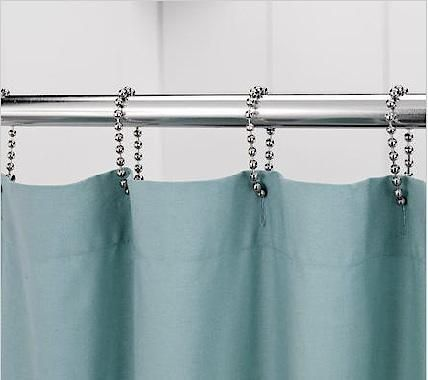 How to hang a DROP CLOTH CURTAIN?  Add buttonhole openings and use these ball chain Shower Curtain Rings at http://www.remodelista.com/posts/bath-ball-chain-shower-curtain-rings