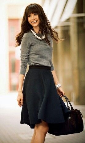 Long A-line skirt knee length, grey jumper sweater, statement necklace, and a great handbag. Autumn winter spring fashion