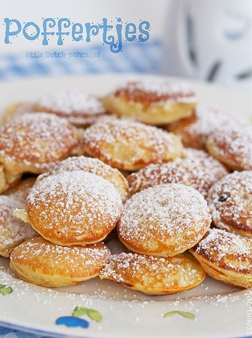 Poffertjes: a delicious treat bought on the stree in Dutch towns: mini yeast pancakes, cooked in a special pan, served covered in icing sugar and with melting butter. Delicious.