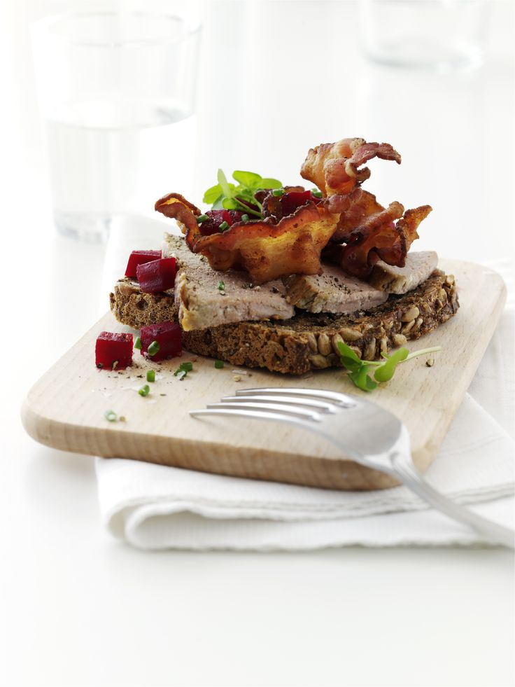 The famous Danish open sandwich, Smørrebrød. This one topped with danish paté and bacon.