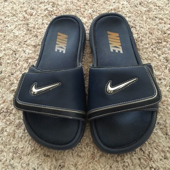 Nike slide on sandals(size 9) Good condition, will be cleaned before shipped. These are a size 8 in men's. I am a size 9 shoe and these fit me perfectly. Memory foam shoes Nike Shoes Sandals