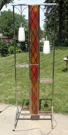 A stained glass panel, lighted, mid-century plant stand room divider