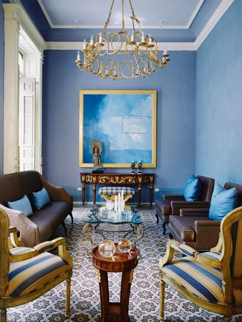 Intricate mosaic tiling combined with carved wood furniture and silk upholstery create a sophisticated living room.http://www.ivillage.com/blue-home-decor/7-a-533801