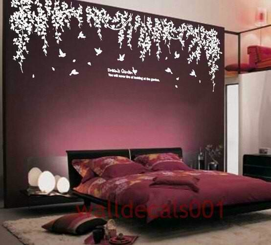 Dark purple room. Good idea with green leaves instead of white