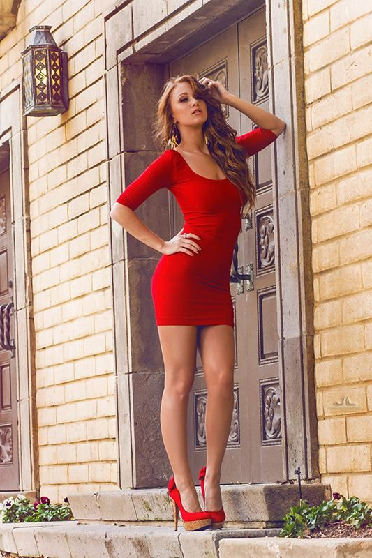 Red mini dress, red cork platform high heels and gorgeous legs.  sexy!