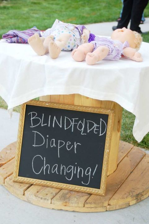 Blindfolded Diaper Challenge – Challenge your guests to a diaper changing contest to see who can do it the best, fastest — and blindfolded. Click through for the entire gallery and for more baby shower games.