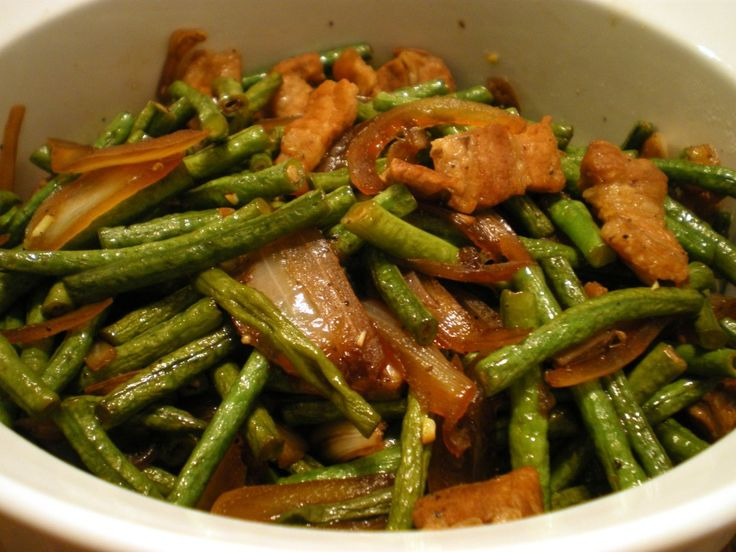 Adobong Sitaw is a vegetable dish composed of string beans cooked adobo style.