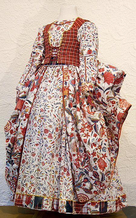 """Dutch dress made from """"sitsen"""", fabrics whose designs were influenced by oriental patterns from the East (=Java, China, India, Japan) brought back by seafarers of the VOC (Vereenigde Oostindische Compagnie=Dutch East India Company) in the 17th/18th century. Initially the fine cotton fabrics,handprinted in India, were only accessible to the Dutch elite.Later, towards the end of the eighteenth century cheaper versions, often printed in Europe, were introduced to the market and began to be used…"""