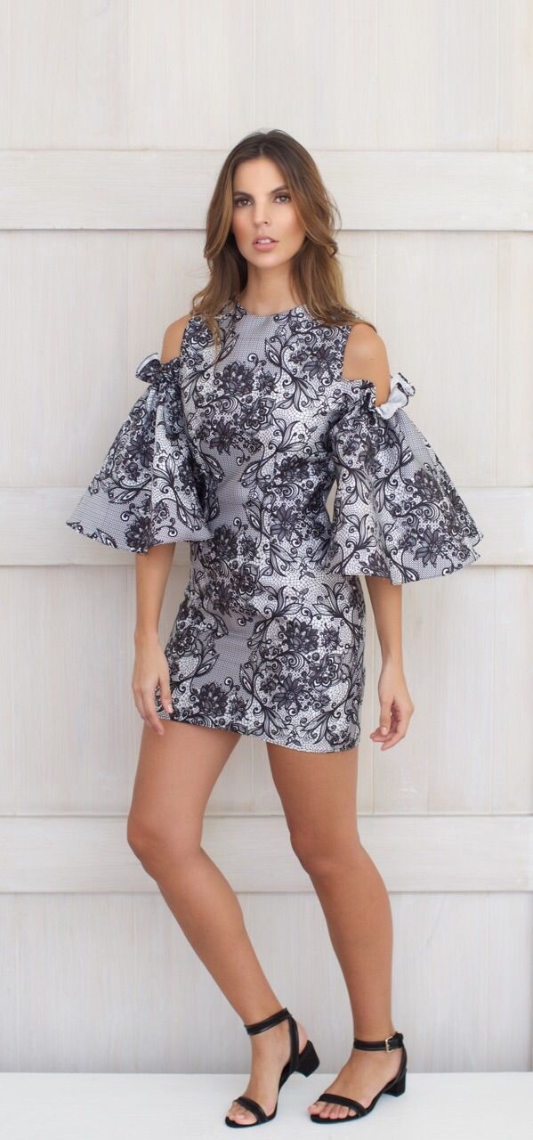 This is our Zahara Dress.  Off the shoulder dress