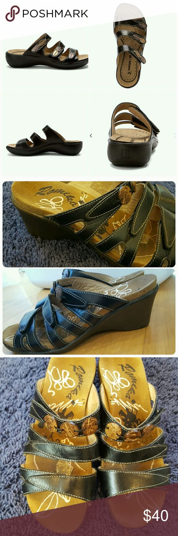 Romika slide sandals. Romika slide sandals. Black leather with wood accents. Straps are completely adjustable.  Soze 36 Euro, size 6.5 US.  Currently for sale online at zappos and shoes.com for $119.95. Romika Shoes