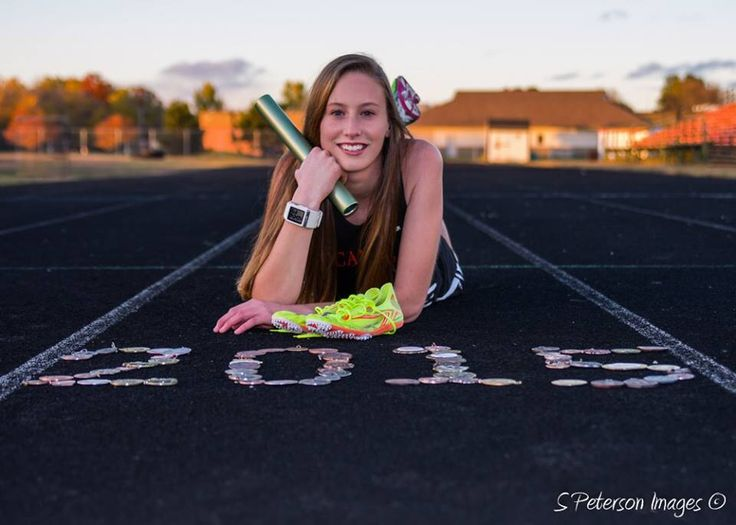 Cross country / track senior picture with graduating year made out of medals won during high school career