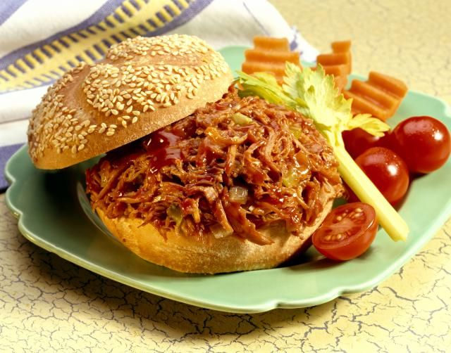 Don't have the equipment for real smoked pulled pork sandwiches? This slow cooker recipe may not be authentic but it's still pretty darn good.
