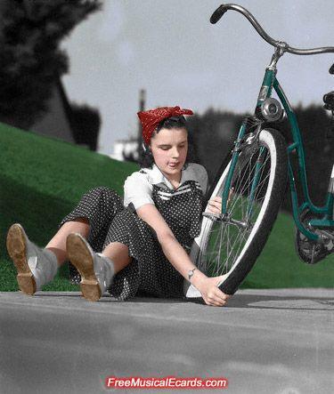 judy garland putting a tire on her bike | Shared from http://hikebike.net