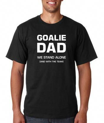 "d9f5354a A saying on this shirt says, ""We stand alone (and with the team)."" Goalie  dads need to stand near the net so they can watch their keeper block those  shots!"