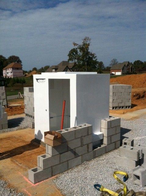New home construction tornado shelters safe rooms for Hidden storm shelter