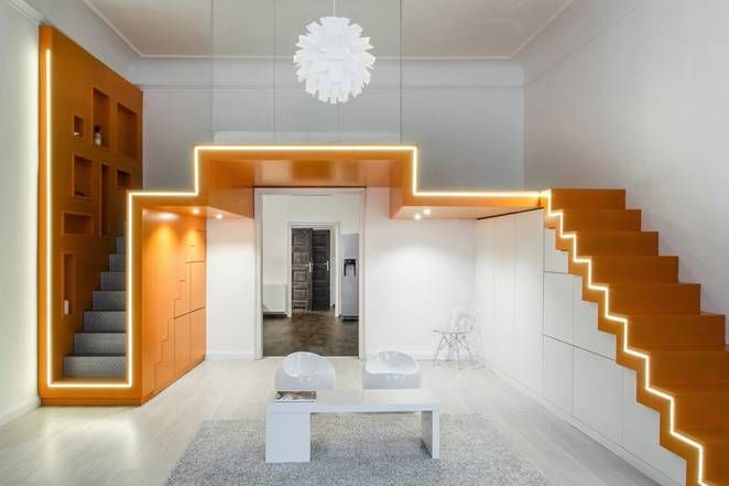 Designing for small lofts: giving easy access to the bed. Hungarian architects Batlab solve the problem: They put a stair up each side.