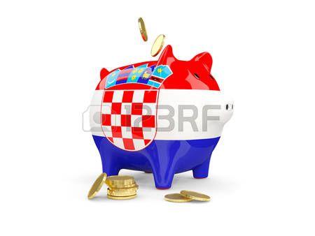 Hucha con monedas y con la bandera de Croacia.