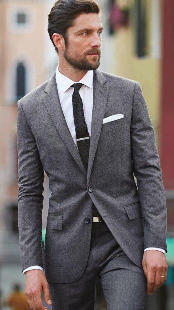 Grey suit, white shirt, tie bar, knit tie.