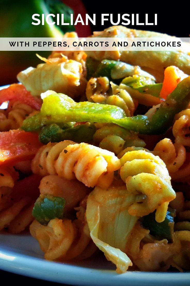 A tasty vegan pasta dish: tricolor fusilli with sauteed veggies and tomato sauce. A great, quick weeknight dinner.