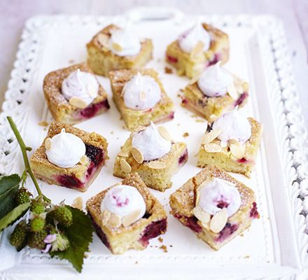 Dainty sponge bites packed with fruit and topped with crunchy almonds and a light meringue whirl
