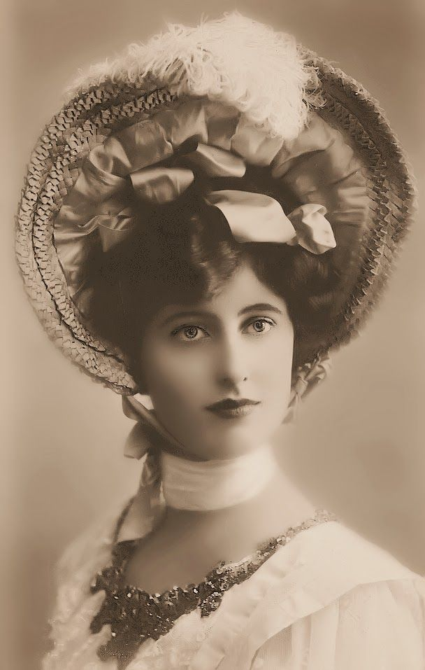 What a beauty, and what a fabulous hat! Bring back the hats I say!