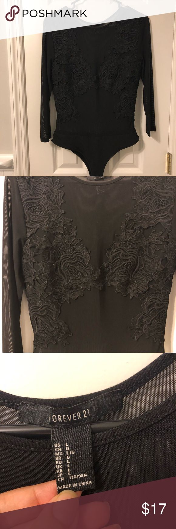 Lace bodysuit forever 21 Very sheer  Lace Great condition  Would be great for fe…