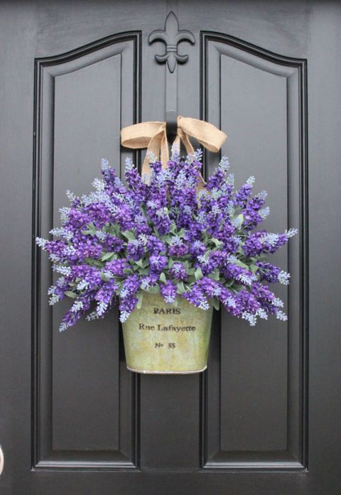 Is there anything prettier than a big bouquet of lavender? Visitors and passerby will be instantly taken with your home as they walk by this beautiful display. (This one features faux lavender, but if you're making your own, you can sub in dried lavender, too.)  See more at Two Inspire You's Etsy shop.