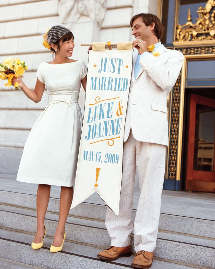 "… to go to new lengths to express myself.     This bride, in a short vintage wedding dress, and groom, in his ""only suit""—made of seersucker—announced their marital status on the front steps of San Francisco's City Hall with a hand-painted banner."