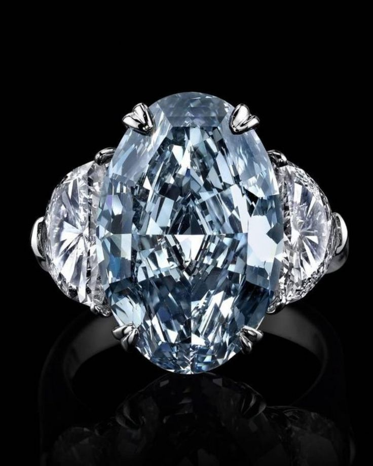 Oval Cut Natural Fancy Blue 3 Stone Diamond Ring With Matching Halfmoons In Platinum