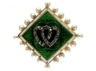 An Edwardian gold, pearl, enamel and diamond brooch depicting two entwined love hearts. (antiquejewellerycompany.com)