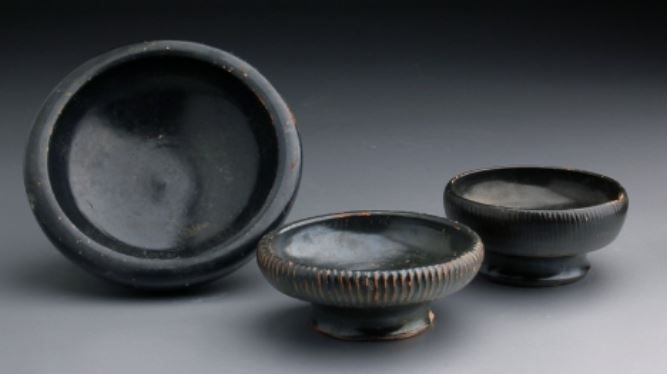 Greek Apulian pottery salt dishes, 4th century B.C. Greek Apulian pottery black glazed miniaturistic vessels, used propably for salt, 11 cm diameter max. Private collection
