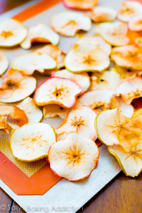 Easy baked apple chips! Crispy, crunchy, cheap, and simple.  These are so addicting and all you are eating is apples. sallysbakingaddiction.com