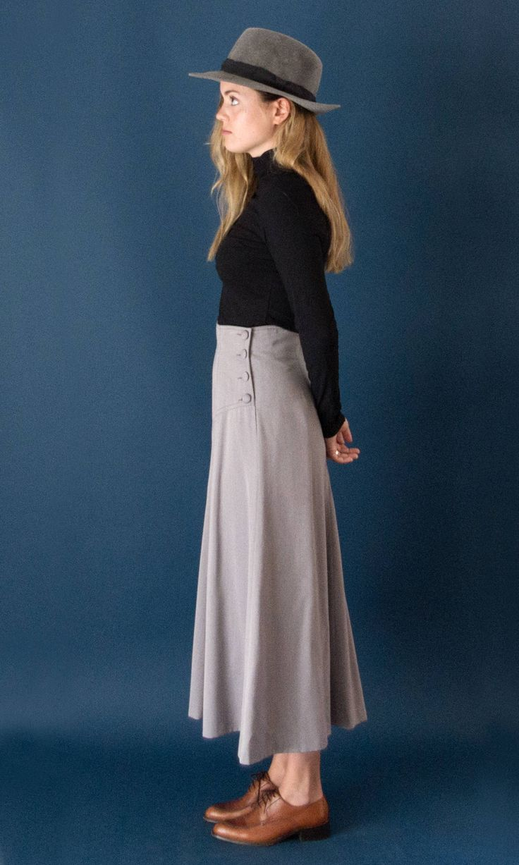 Vintage 1990s grey midi skirt. High rise with side button closure, false pocket and beautiful asymmetric seaming. Fully lined, zip closure at back.  ---- Measurements ---- Estimated size*: M Waist: 27.6 - 70 Cm Hips: 38.6 - 98 Cm Length: 35.4 - 90 Cm *Sizes are for guidance, please check your measures! ---- The Details ---- Label: Guy Laroche para el Corte Inglés Fabric: Polyester, wool, viscose Condition: Excellent  - More vintage Skirts/Pants - https://www.etsy.com/shop&...