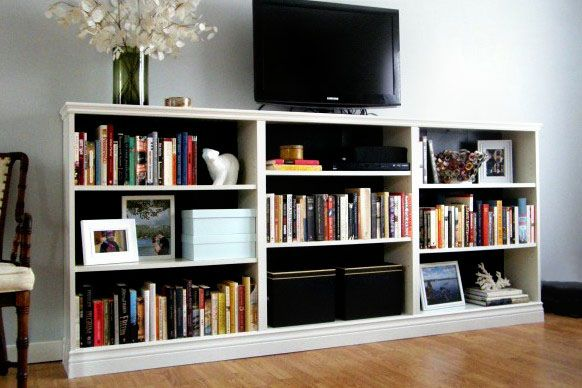 3billy bookcases from IKEA. long trim at the top/bottom to unify it ...
